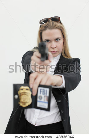 stock-photo-a-sexy-fbi-agent-aiming-a-pistol-48836044