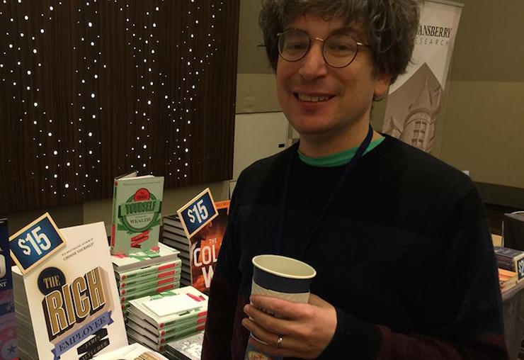 james altucher with a cup